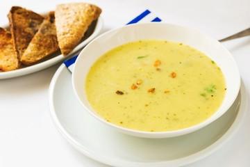 Dense vegetable soup on white background.
