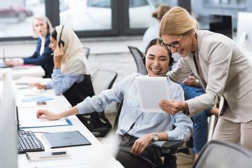 multicultural businesswomen using tablet