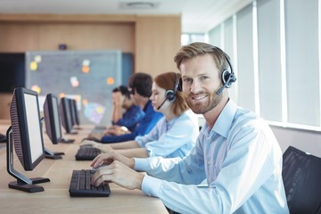 Portrait of smiling businessman working at call center
