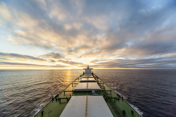 HDR  photo of a cargo ship at sea against sunset