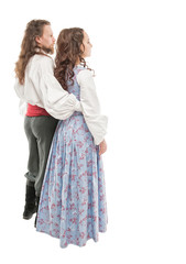 Beautiful couple woman and man in medieval clothes. Turn pose