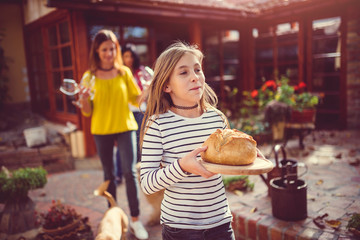 Girl holding fresh loaf of bread