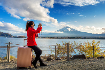 Woman take a photo at Fuji mountains. Autumn in Japan. Travel concept.