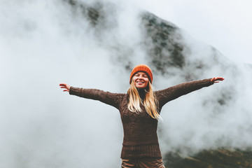 Happy woman emotional raised hands foggy mountains on background Travel Lifestyle success motivation concept adventure active vacations outdoor
