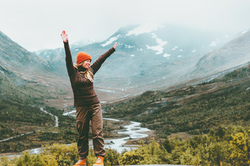 Traveling Woman happy enjoying foggy mountains landscape outdoor emotions Lifestyle success concept adventure active vacations in Norway Jotunheimen park