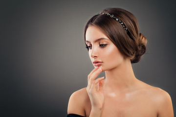 Perfect Girl Fashion Model with Wedding Hairdo, Makeup and Hair Accessories. Fashion Portrait of Young Woman
