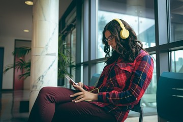 Girl listening music on mobile phone
