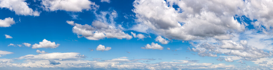 Blue sky with white fluffy clouds panorama Wall mural