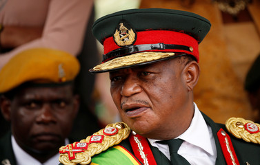 Commander of Zimbabwe Defence Forces General Constantino Chiwenga looks on after the swearing in of Emmerson Mnangagwa  as Zimbabwe's new president in Harare
