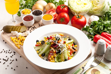 Leaf vegetable salad with many vegetable objects