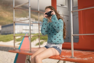 Teenage girl clicking photo with camera
