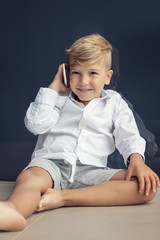 Happy kid talking on cell phone.