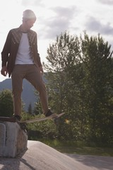 Man skateboarding on the road