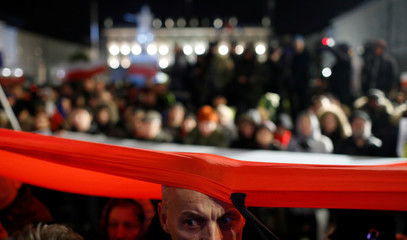 People gather in front of the Presidential Palace during a protest against judicial reforms in Warsaw