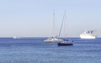 Several boats on the blue clean natural sea for transportation or vacation
