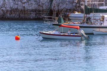 Several docked vintage wooden motor boat