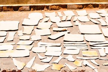 Pieces of leather drying in the sun in the tannery, Marrakech, Morocco before going on sale in the Souk.