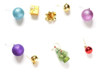 Christmas gifts flat lay photo/ Blue, purple, golden, pink glitter balls, Christmas tree decor, yellow gift box and decorative bow. New Year decoration. Mock-up, free space for text