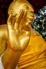 Statue of Lord Buddha with selective focus at wat thai Buddhist monastery.