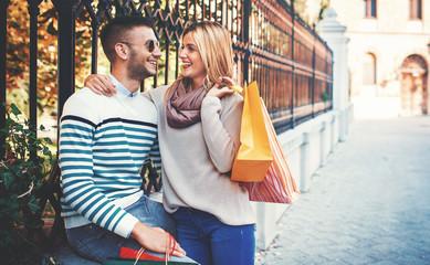Loving couple enjoying in shopping. Consumerism, love, dating, lifestyle concept