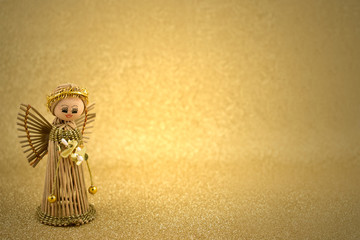 Christmas angel stock images. Christmas angel on a golden background. Golden holiday background. Golden decorations on shiny background with copy space for text