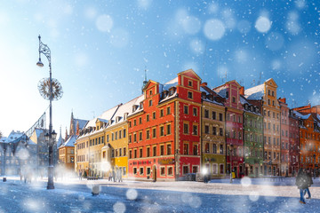 Wall Mural - Multicolored traditional historical houses on Market square in the winter snowy morning, Old Town of Wroclaw, Poland