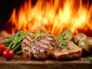 freshly grilled steaks and vegetables