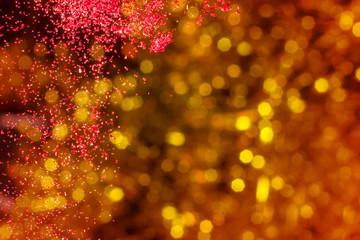 christmas background, red glitter dropped with golden background
