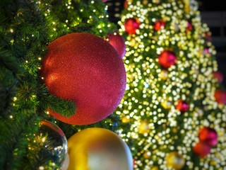 Many Christmas Ornament On Tree In Front With Blur Background Big Lighting
