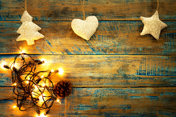 Wall Mural - Christmas lights bulb with decoration on wood table. Merry christmas (xmas) background. topview, border design - rustic and vintage styles