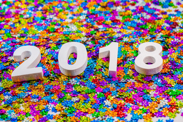 year 2018 on colorful flowers glitter.