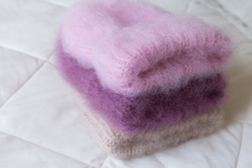 Fluffy hats of various styles and colors hand-knitted