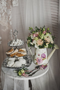 A tiered tray with desserts 285.