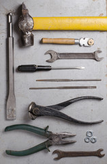 Set of hand old tools on grey background. Top view