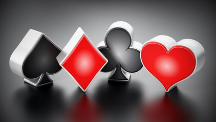 Playing card suits symbols standing on black background. 3D illustration