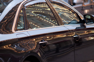 beautiful car with reflection of illumination on the surface
