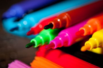 Felt pens bright, colorful on a dark background