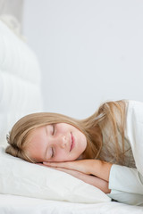 Happy teen girl sleeping in bed. Space for text