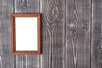 Frame isolated white chalkboard on wooden background. Mock up.