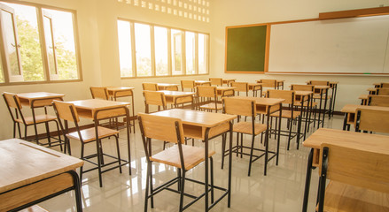 Lecture room or School empty classroom with desks and chair iron wood for studying lessons in high school thailand, interior of secondary education, with whiteboard, vintage tone educational concept