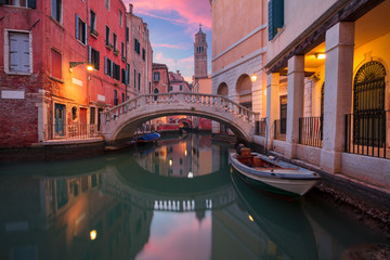 Venice. Cityscape image of narrow canals in Venice during dramatic sunset. Wall mural