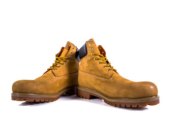 Pair of brown hiking boots isolate on a white background Wall mural