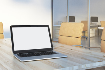 Empty laptop in conference table