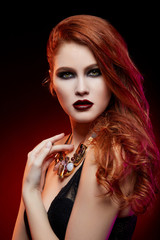 beautiful girl with bright makeup and red hair