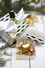 Christmas decoration, gift boxes close-up view with copy space on white wood table surface.