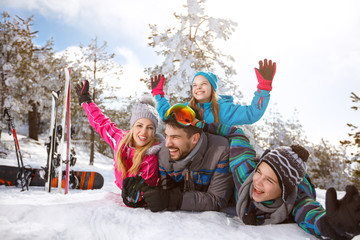 Family together on snow on winter holiday