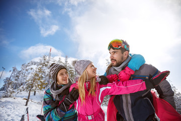 Female with husband and children on winter holiday in mountain