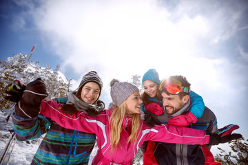 Woman with family having fun on skiing