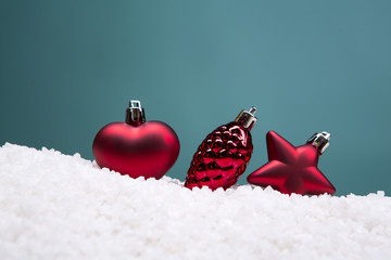 Christmas card - white and glass balls and Christmas toys on a snow slide. Close-up, beautiful picture.