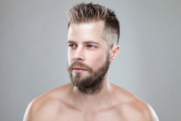Portrait of young bearded man with a new hair cut